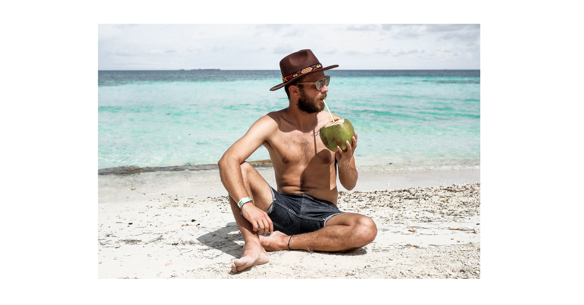 basilio on the beach coconut hat man
