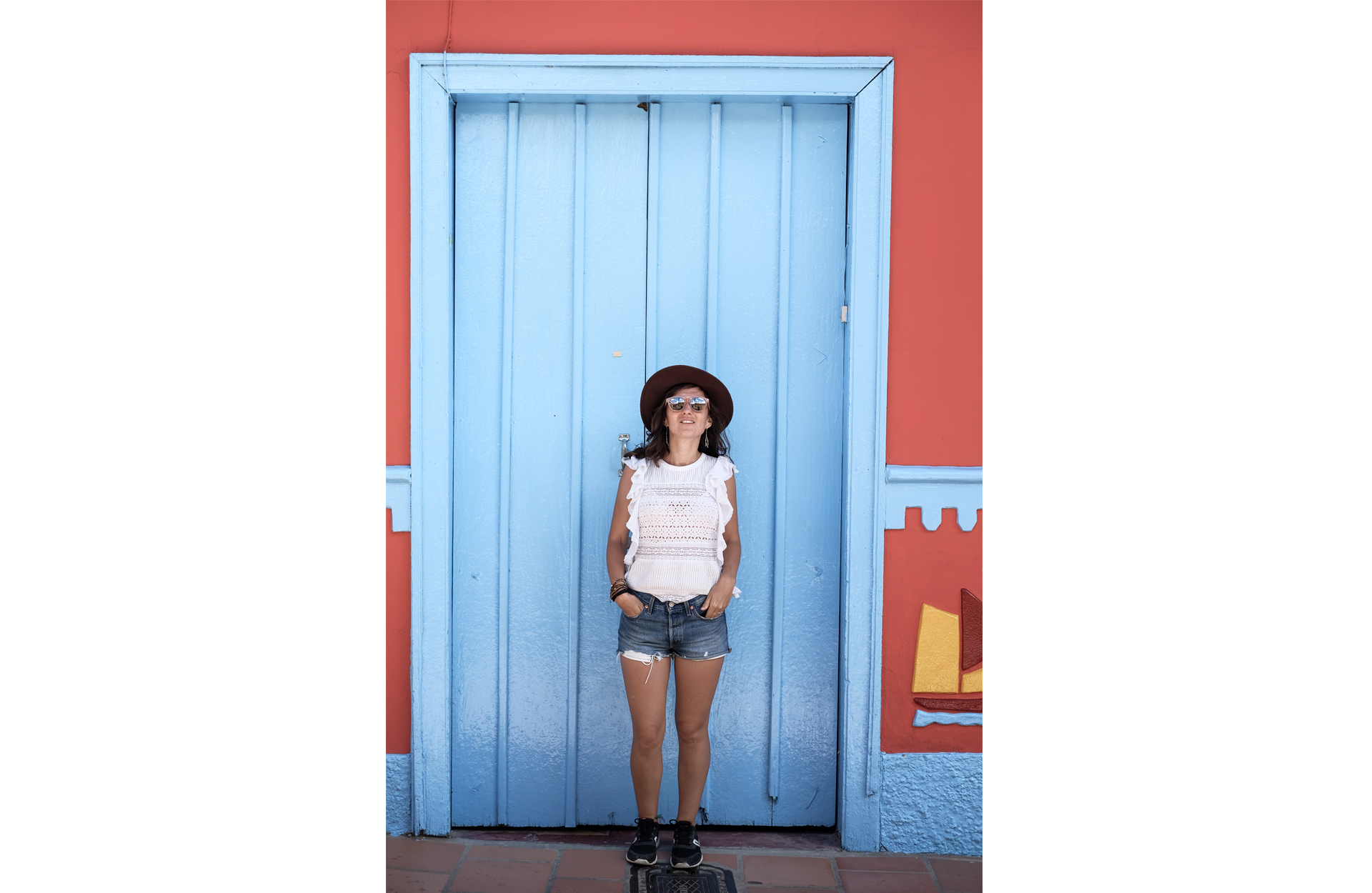 woman front a blue door