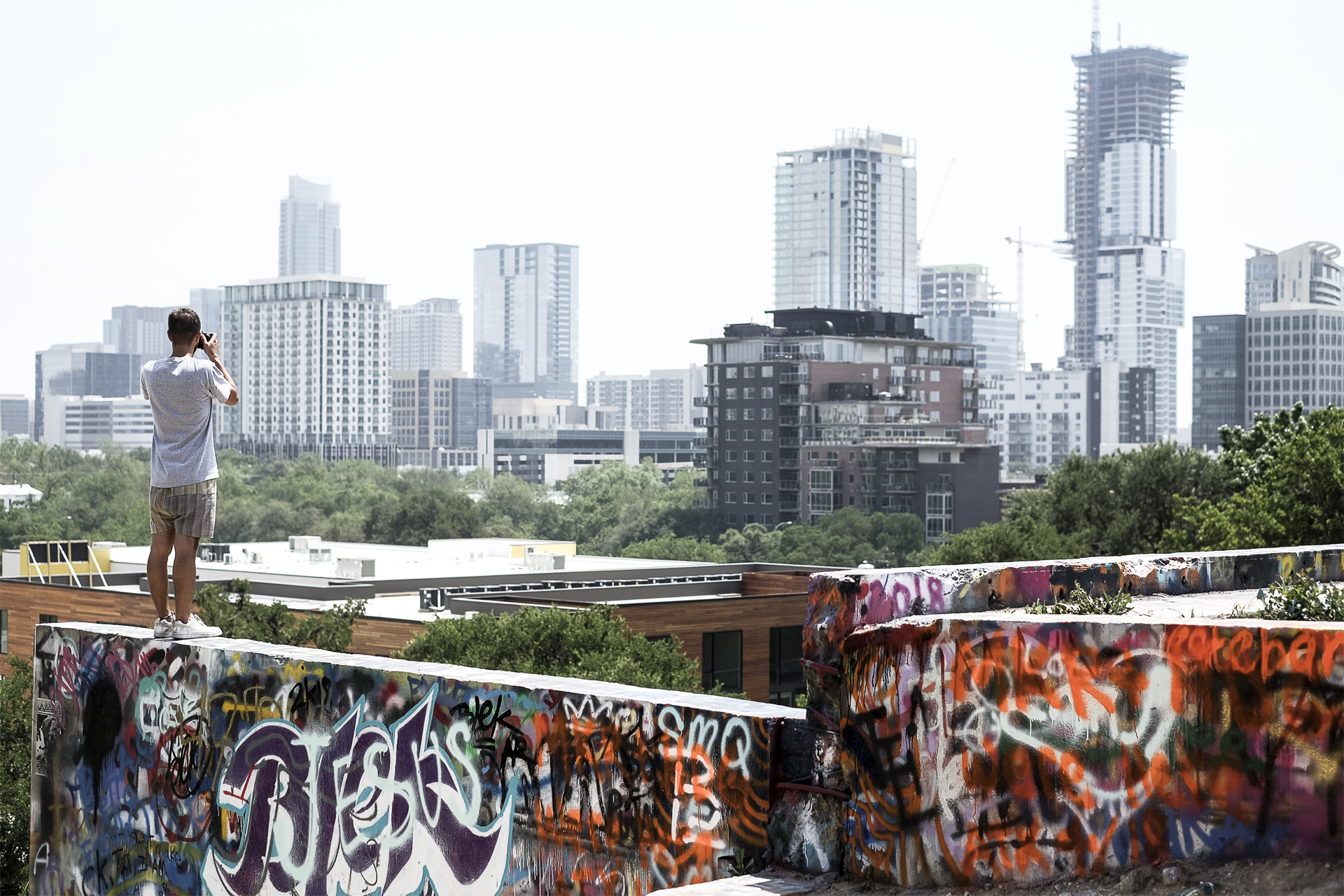 view of Austin with buildings and street art walls