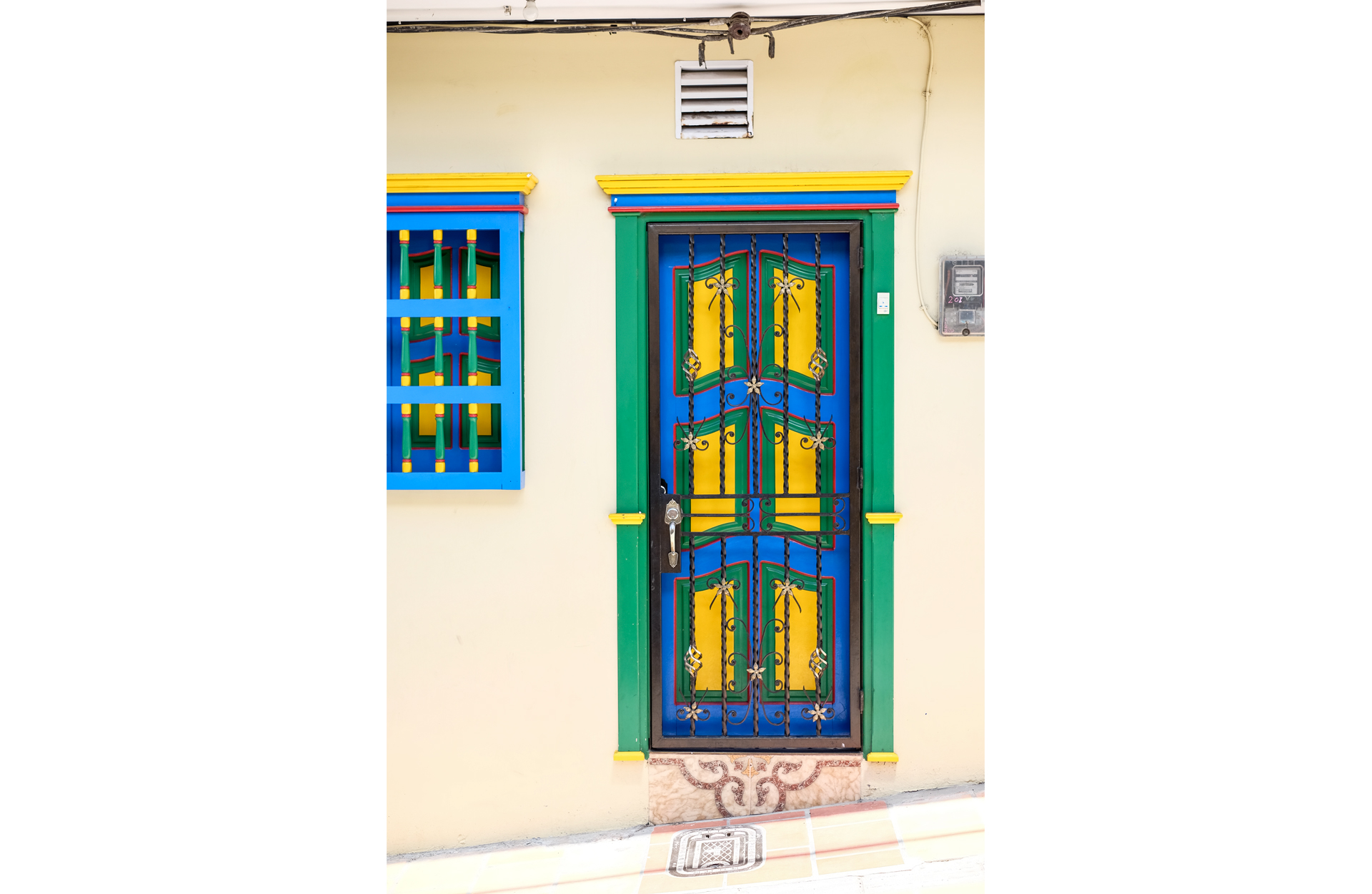 blue yellow green colorful door with bas-reliefs in guatape