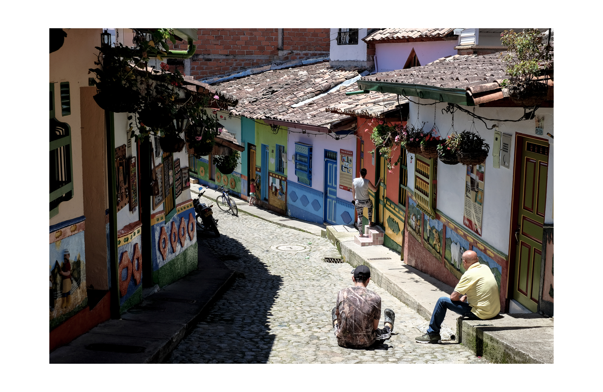 view of the street of guatape and the bas-relief