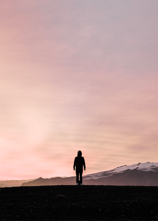 Basilio in Iceland with a orange and pink sunset