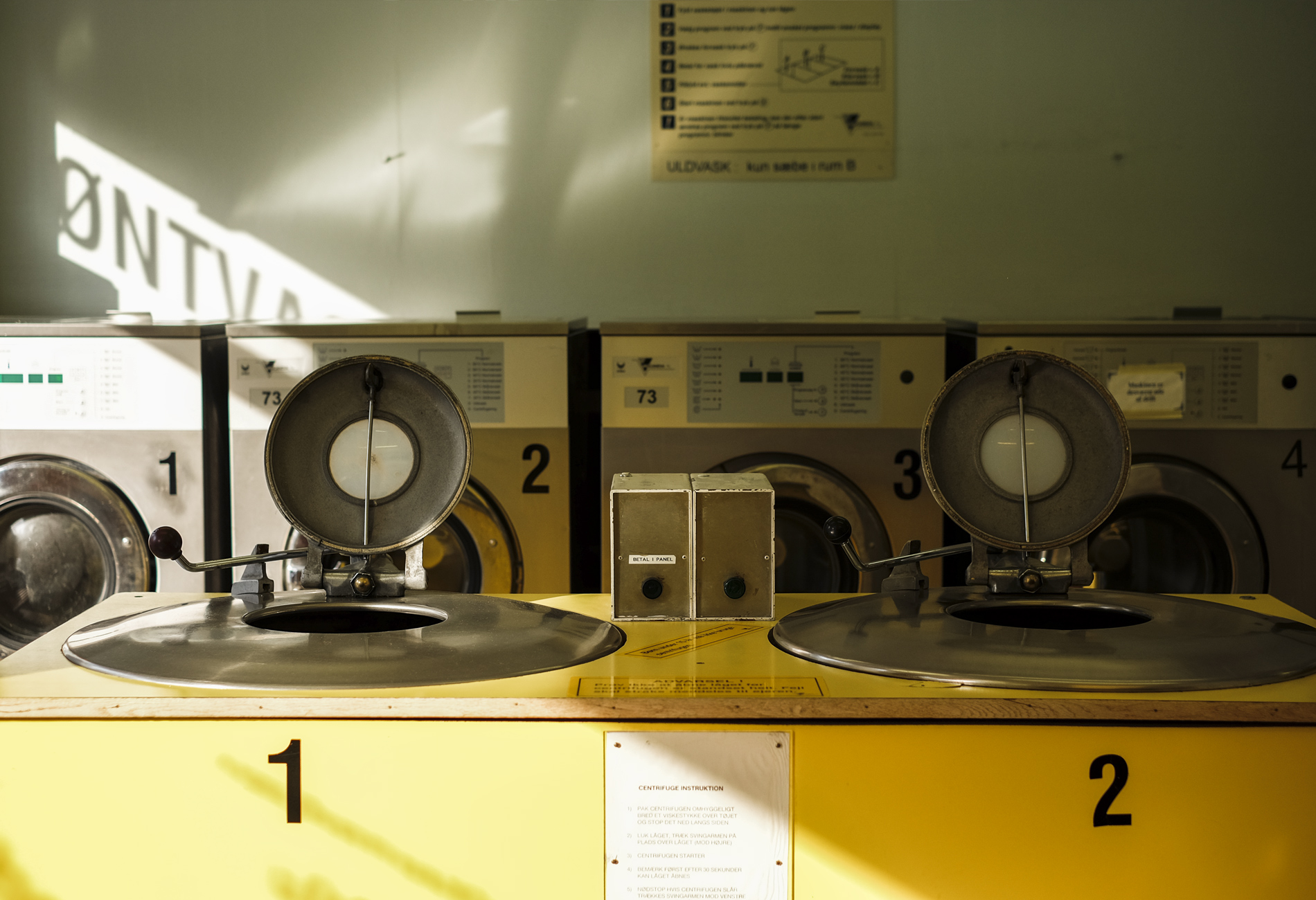 laundry with yellow machines with the numbers 1 2 3 in Copenhagen