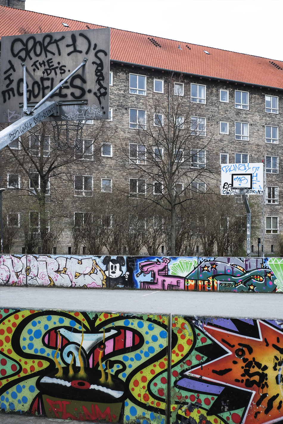 basketball court with building full of Windows behind in the Danish capital