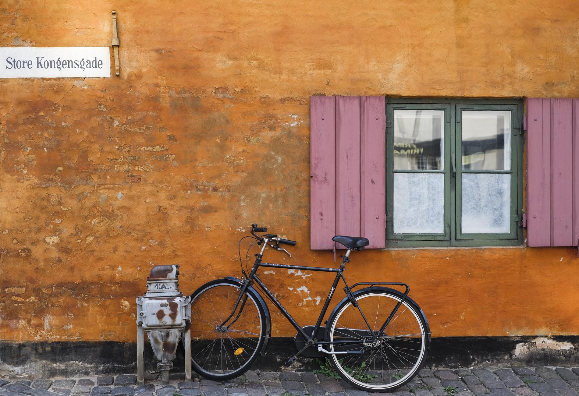 bike and yellow wall