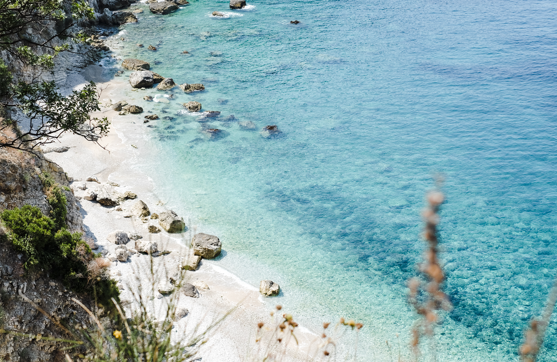 White sand and clear water beach, seen from the top Road trip in Albania