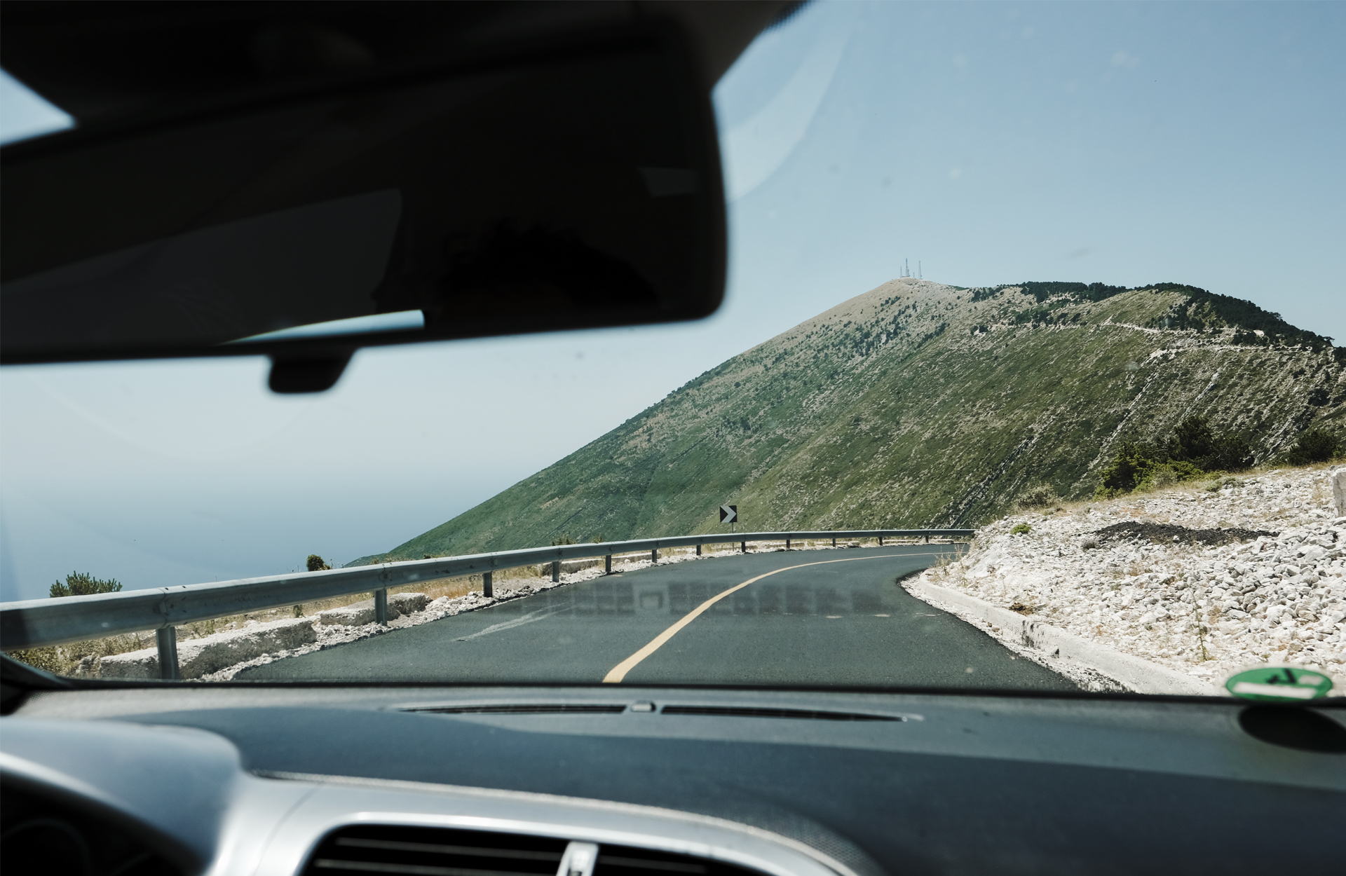 Car front window looking atime a mountain Albania
