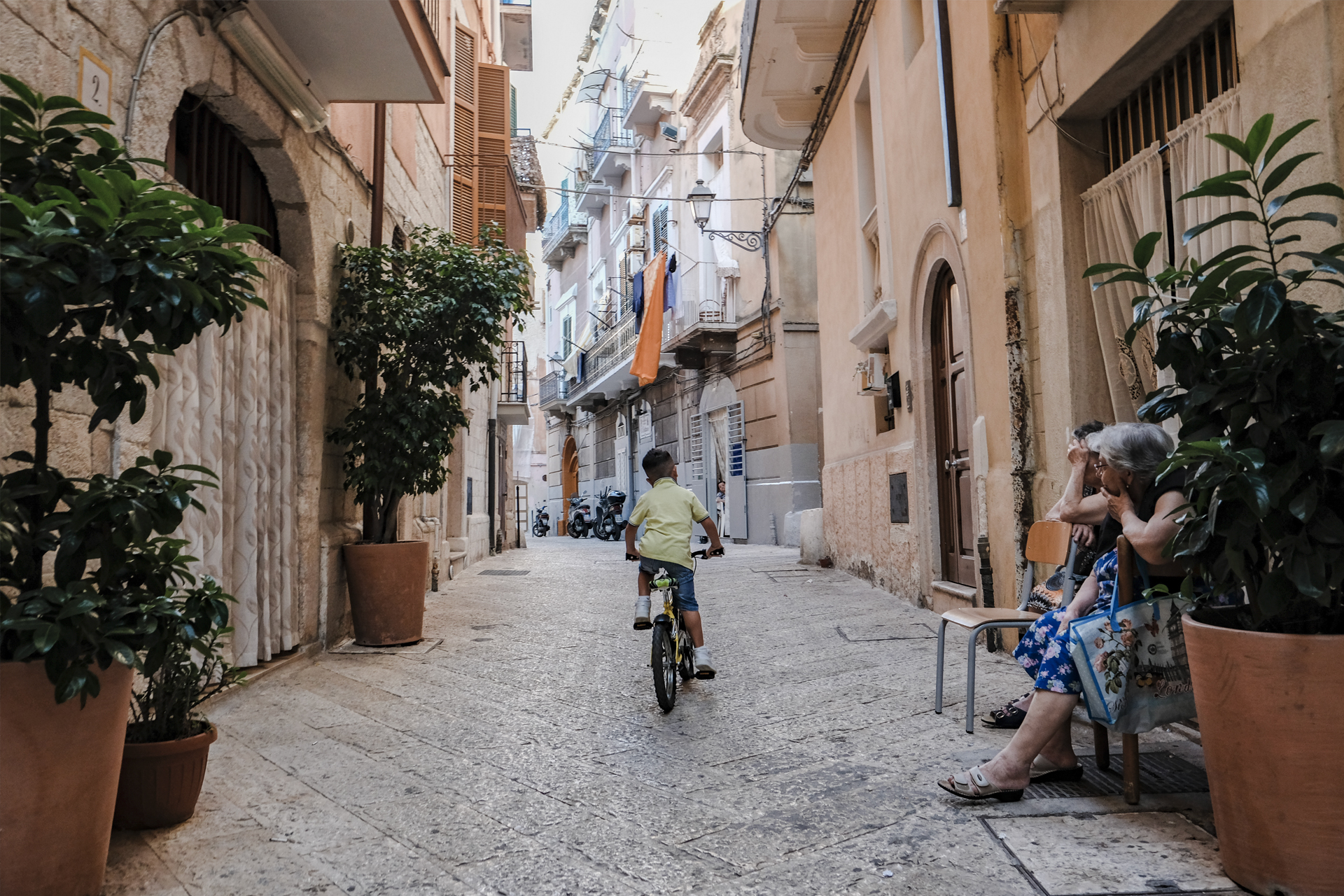 kid riding a bike, A glimpse of Puglia