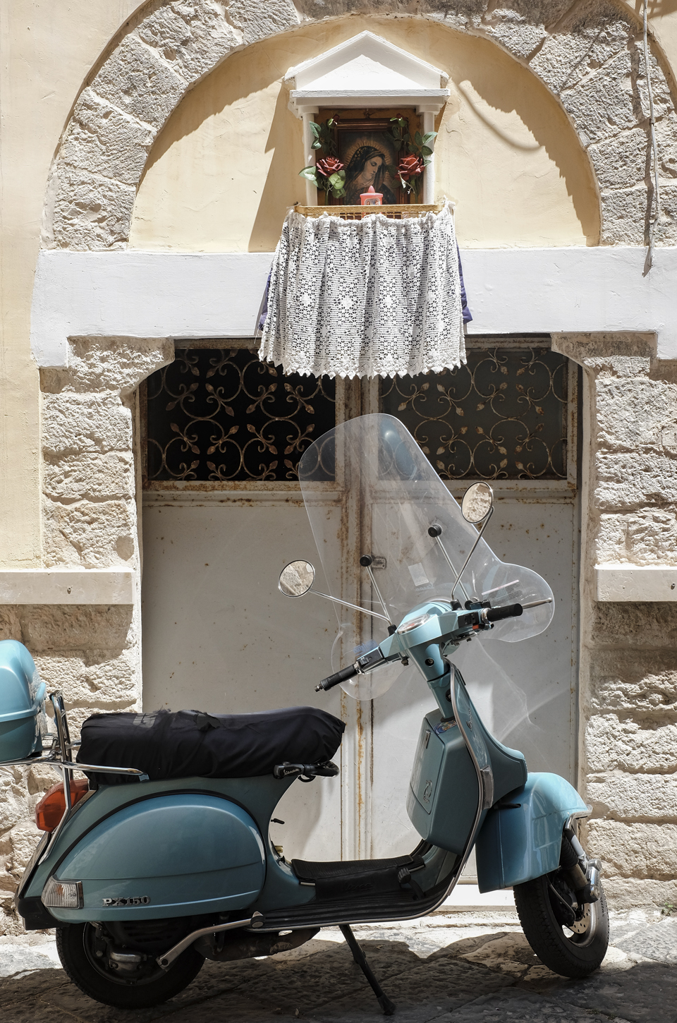 A glimpse of Puglia, blue scooter parked in Bari