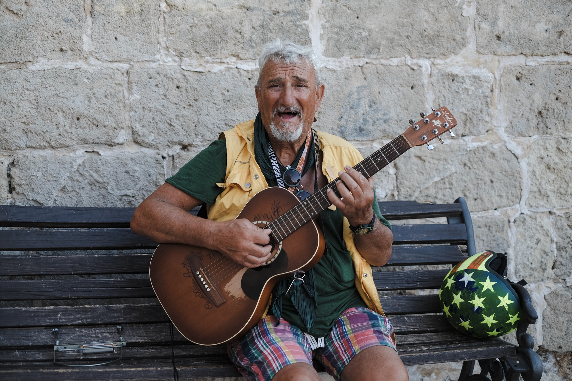 A glimpse of Puglia, Tony playing the guitar on a bench in Polignano