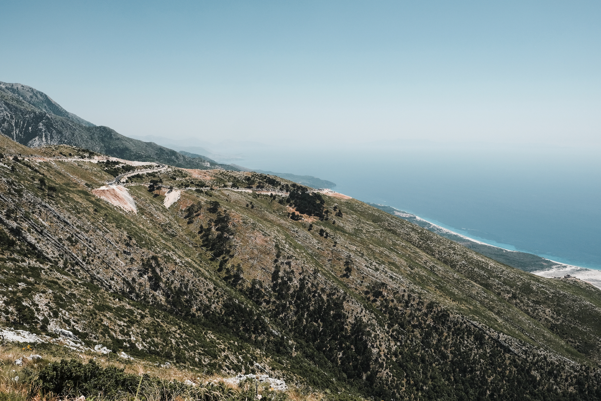 winding road going down to the coast and best beaches in the Riviera