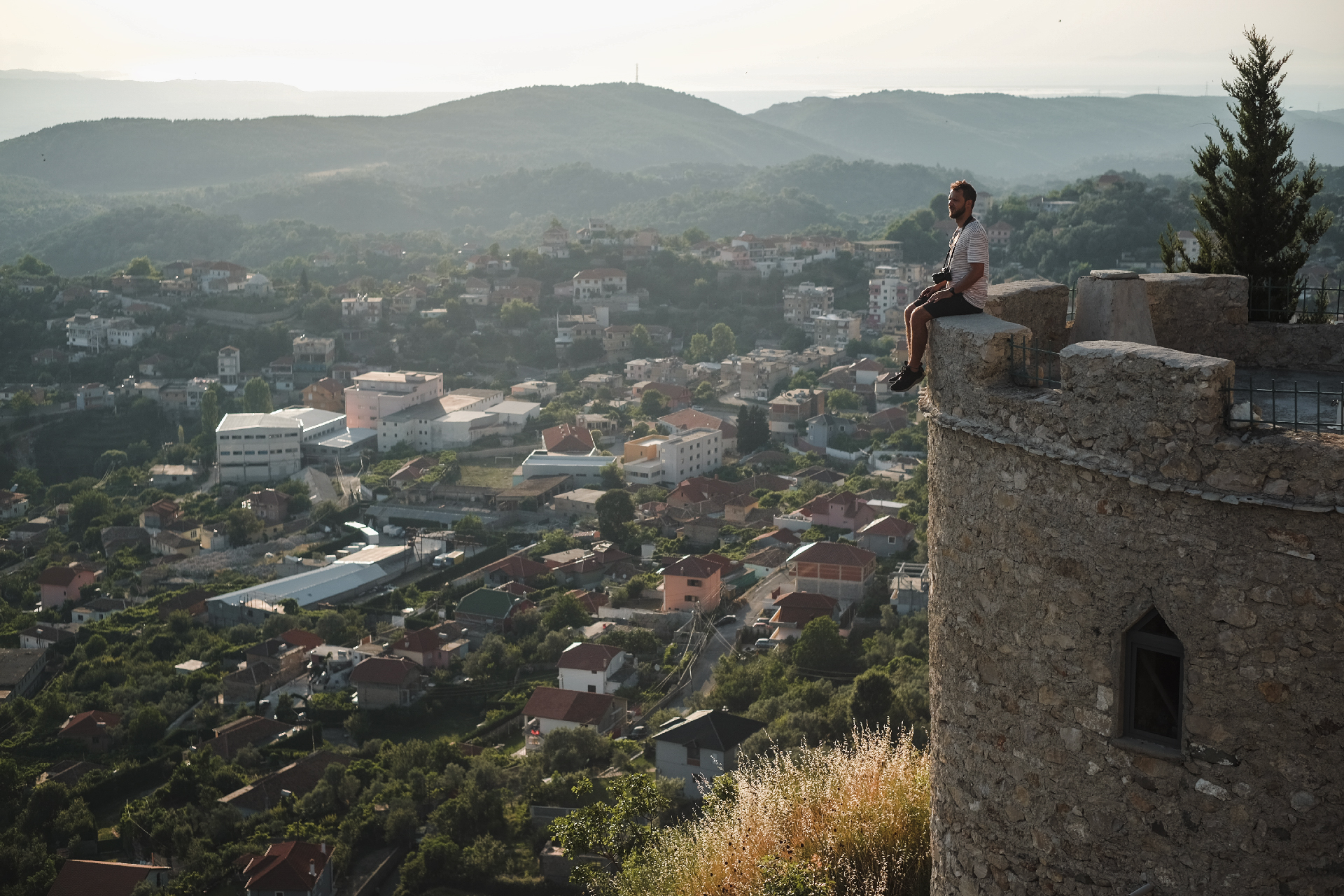 man sitting at the edge of the castle, the center of Albania