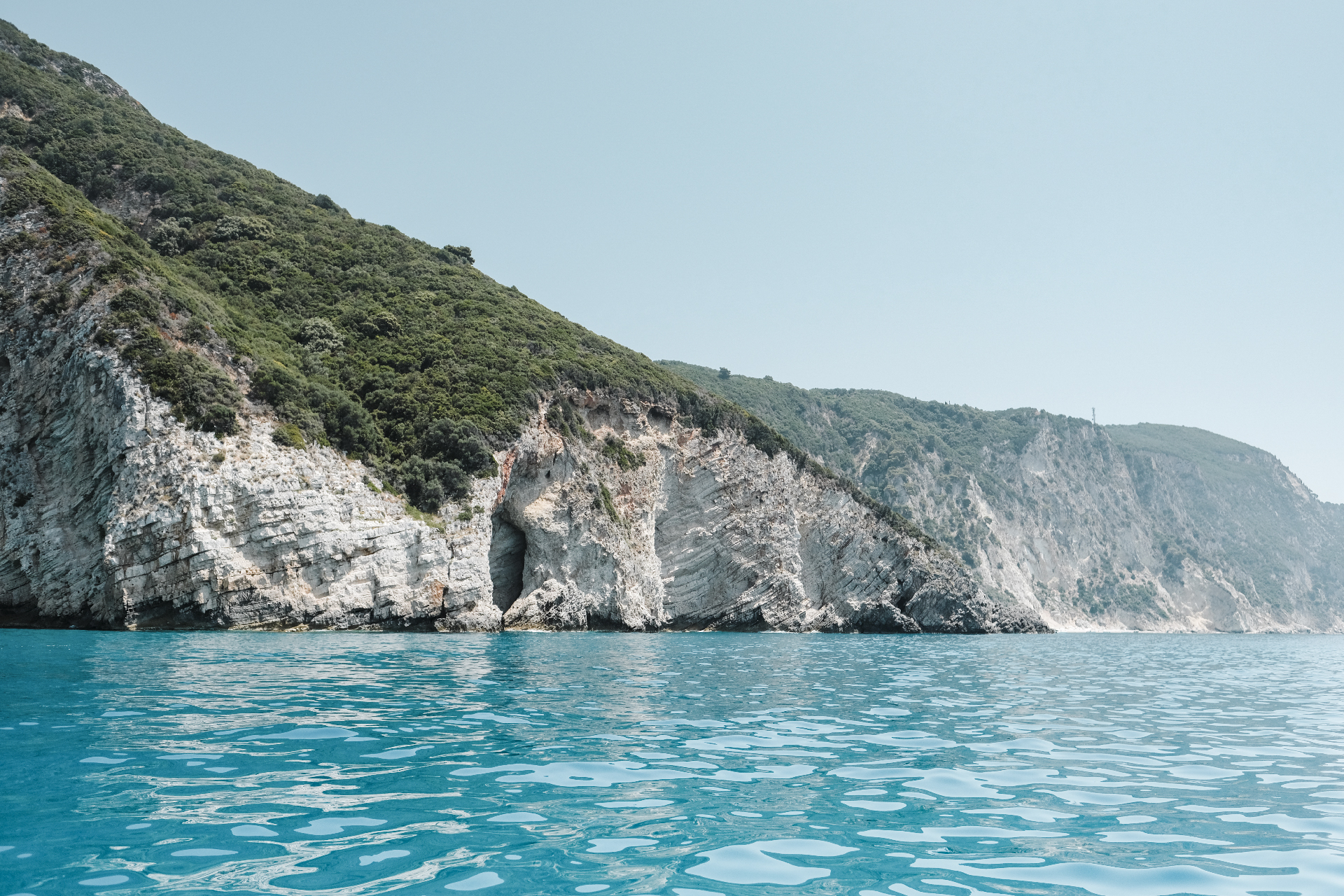 Cliffs of the Adriatic sea seen from a boat, things to do in Corfu