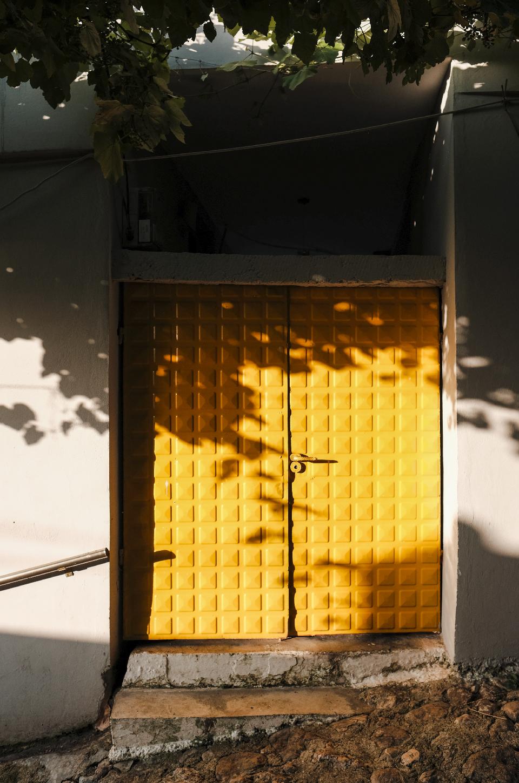 Yellow door in the streets of Krujë