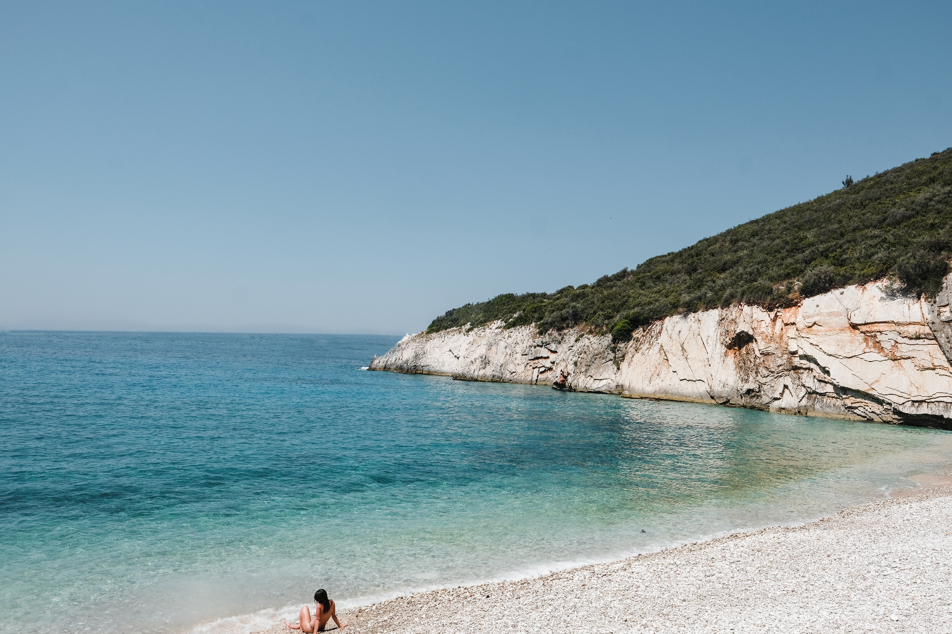 girl tanning at the beach , road trip in Albania