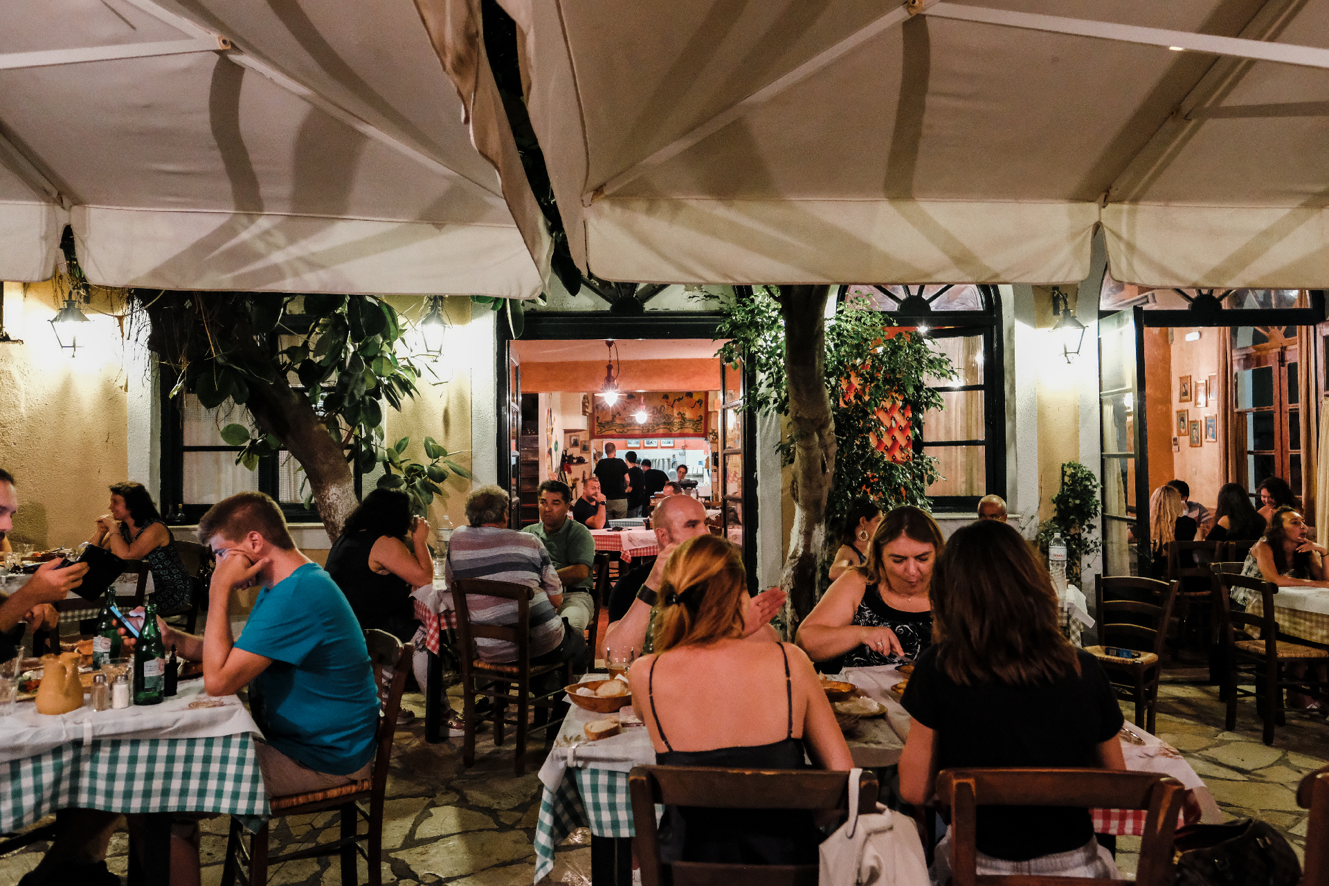 People having dinner at a restaurant, things to do in Corfu