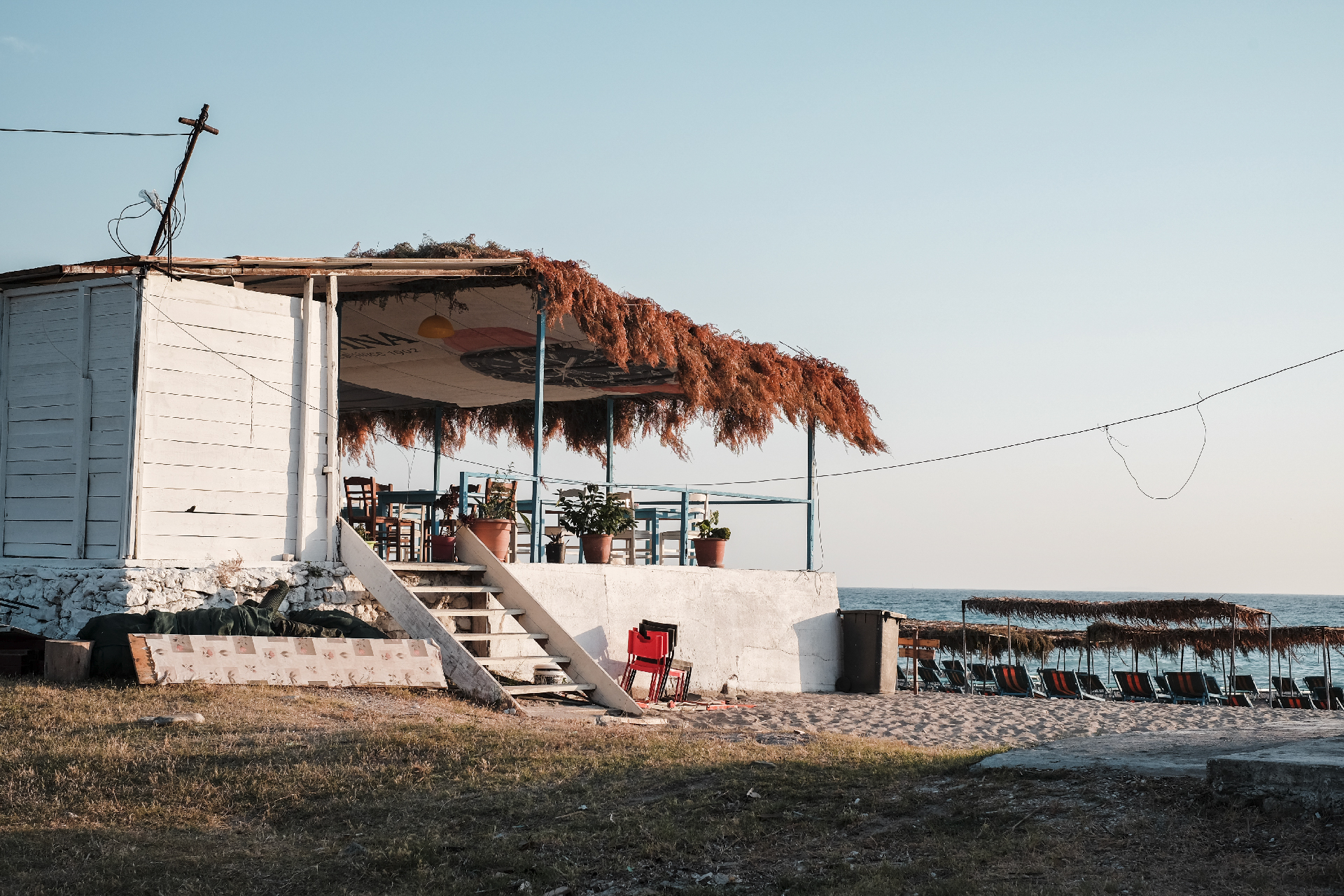 White hut restaurant with beach front road trip Albania
