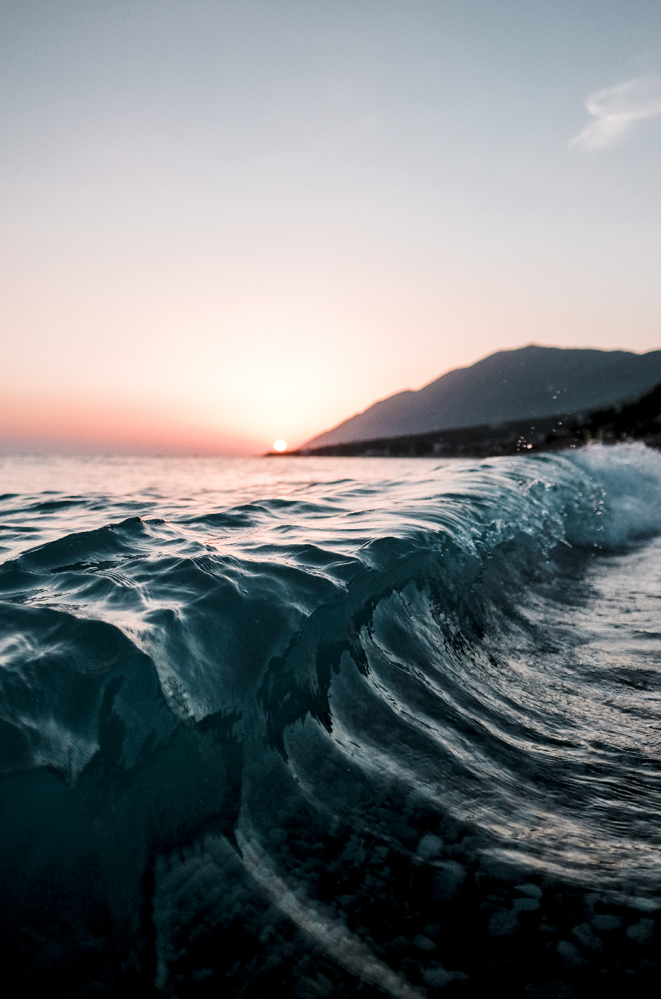 Wave breaking at sunset, best beaches in the Riviera, Albania