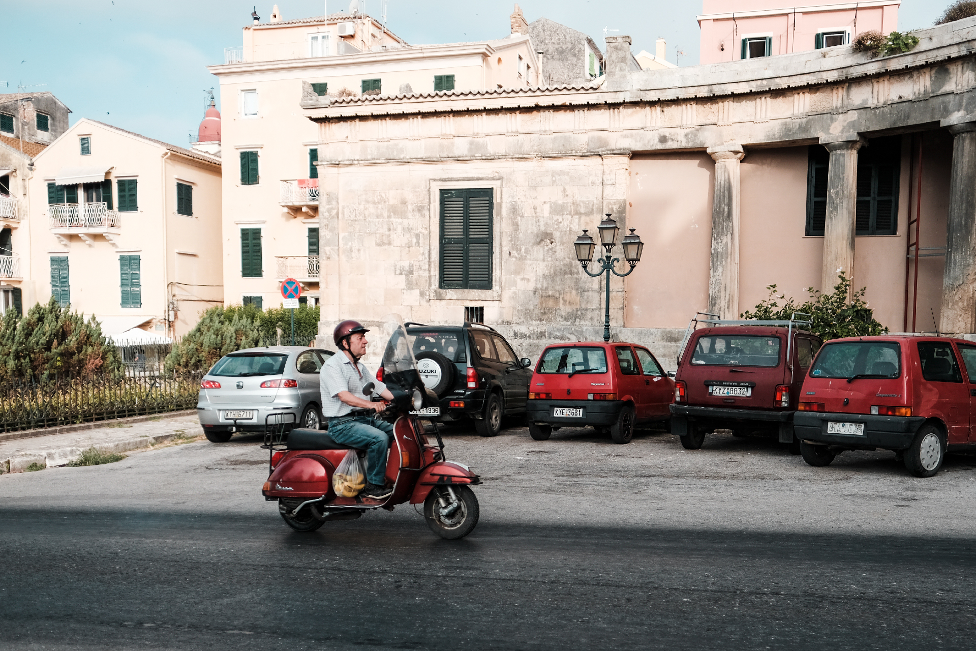 Old man driving a scooter, things to do in Corfu