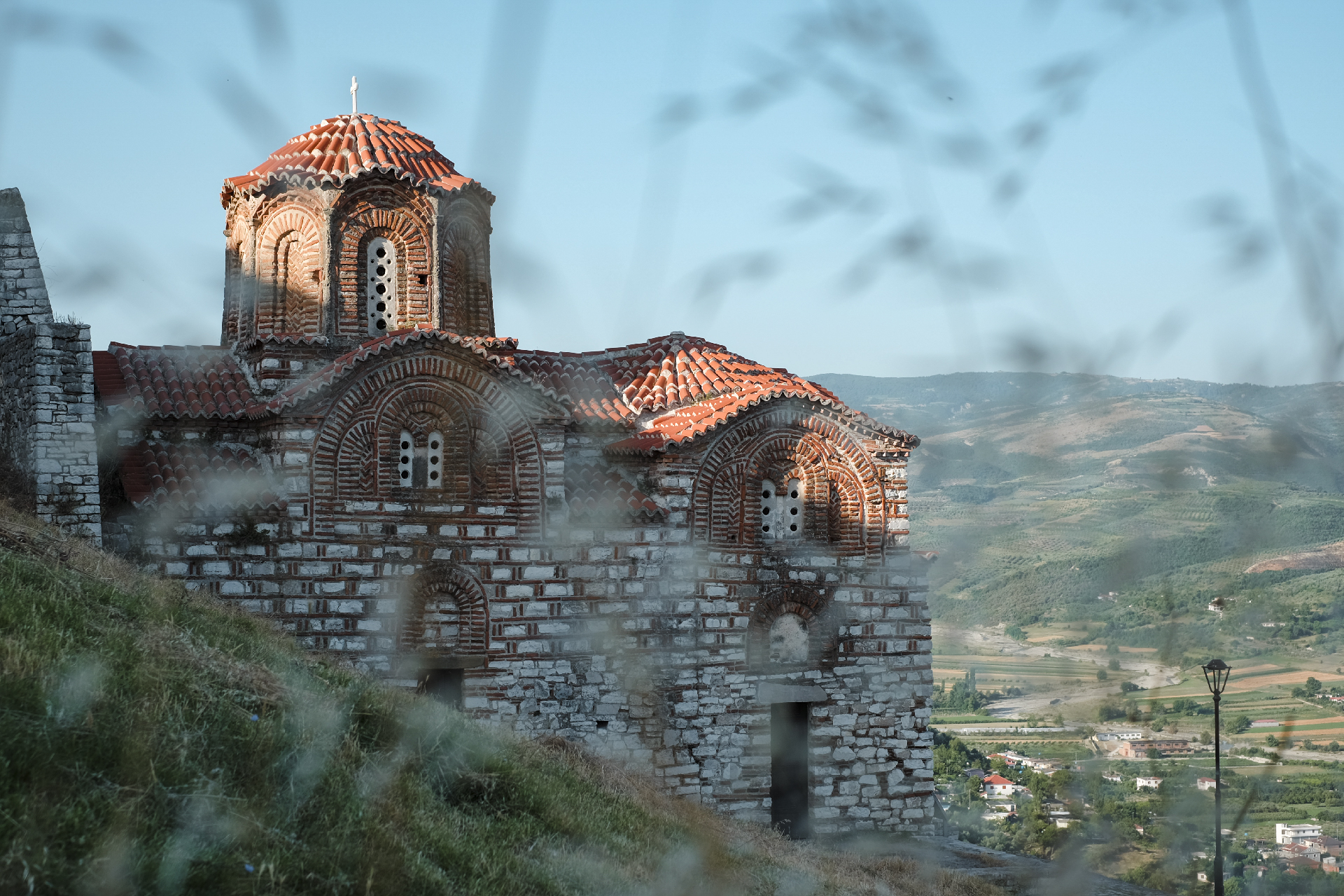 Orthodox church hidinh behind the herbs in the mountains of Berat