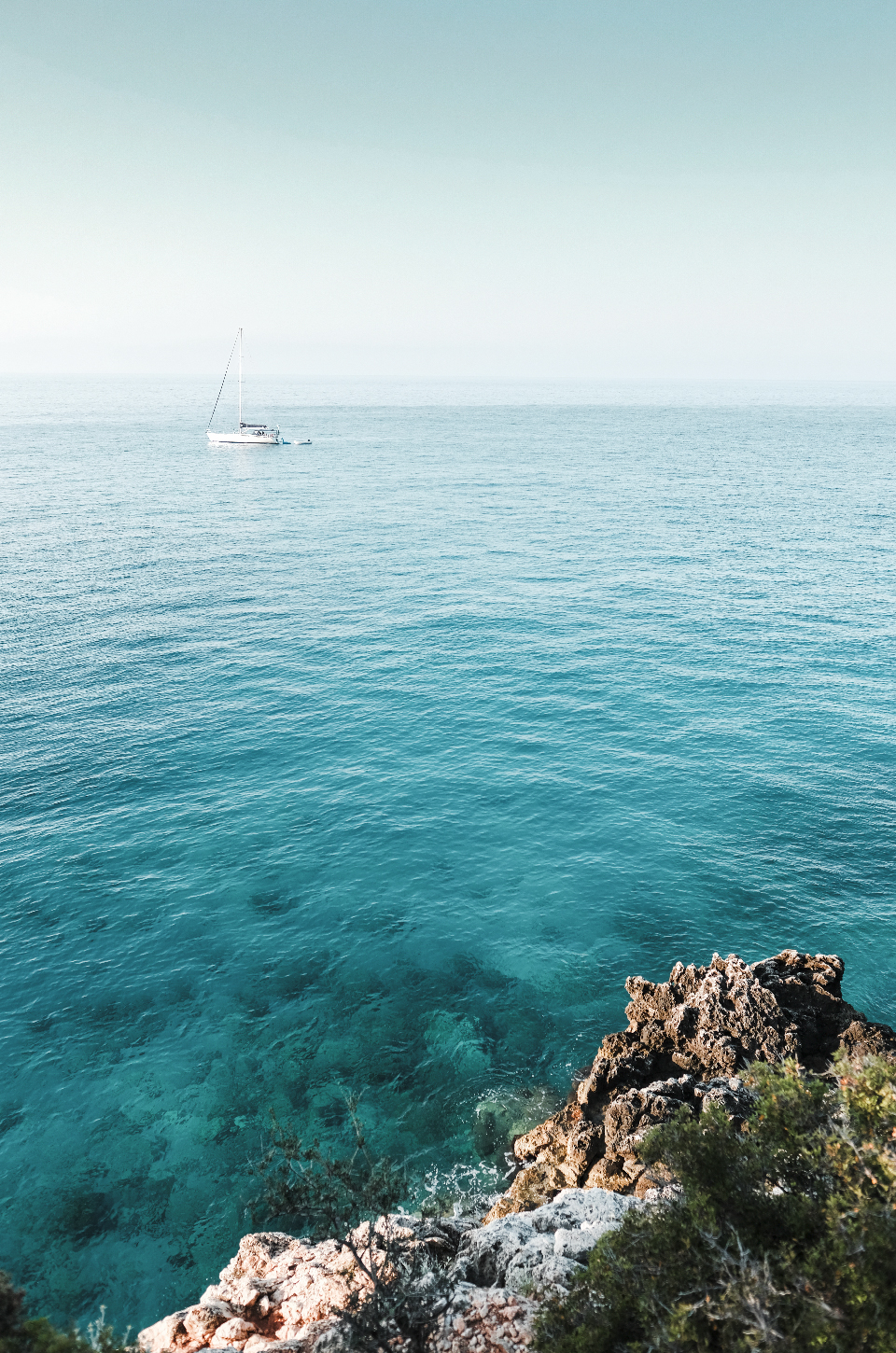 Turquoise water and a boat, best beaches in the riviera Albania