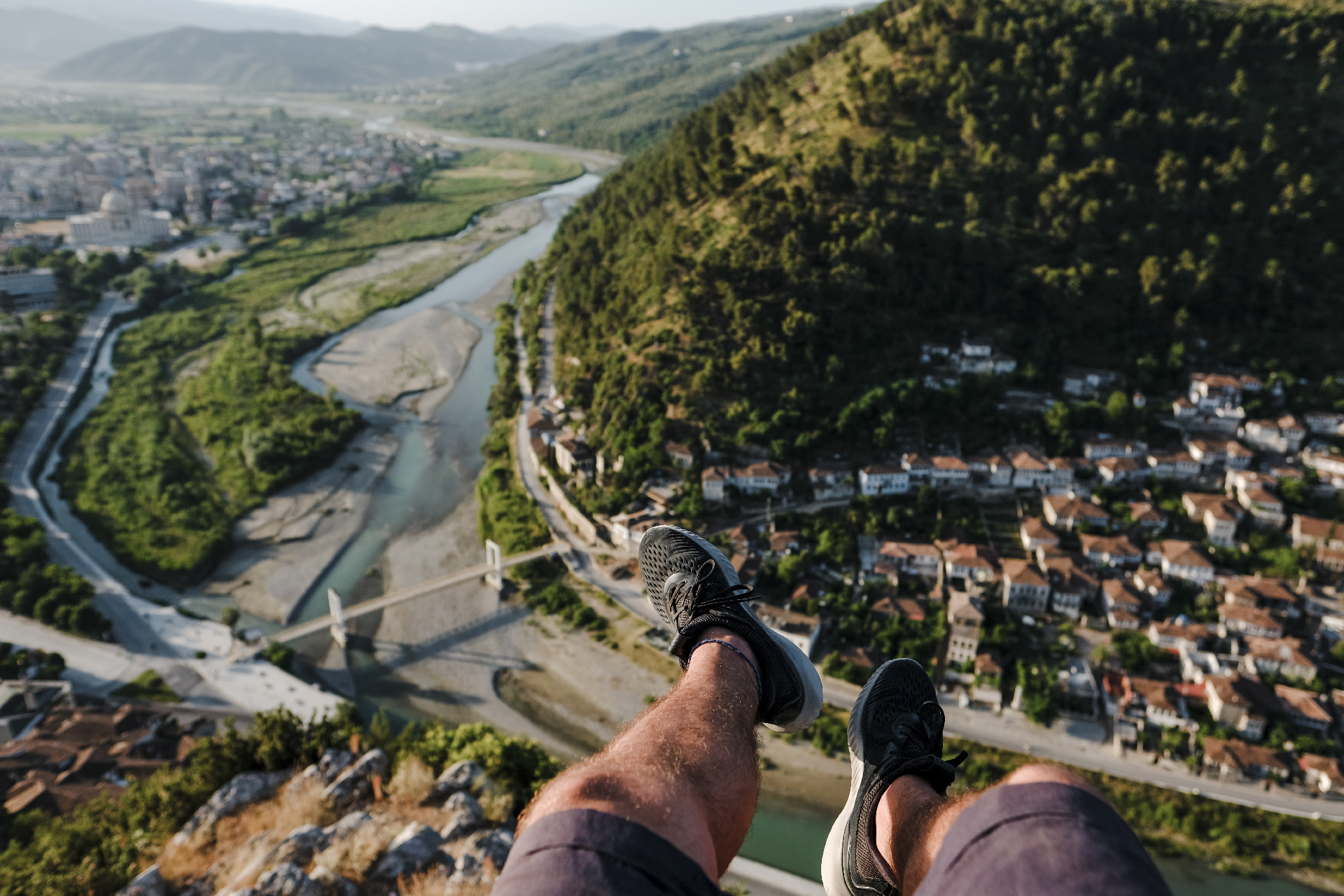 legs looking at the view of the valley and Berat