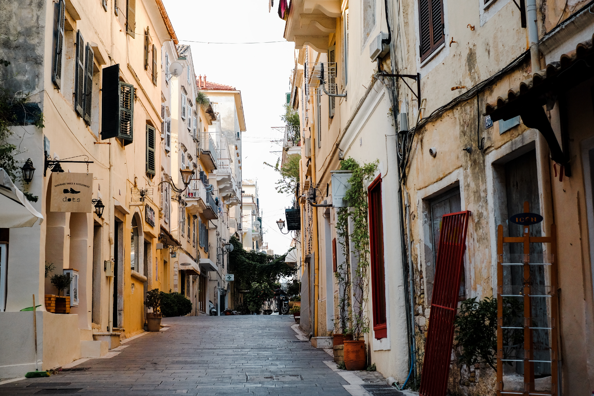Street with yellow buildings in Corfu's old town. things to do in Corfu.