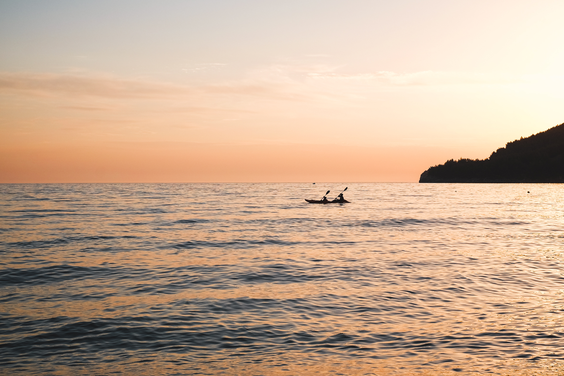 two persons in a kayak at sunset, best beaches in the Riviera