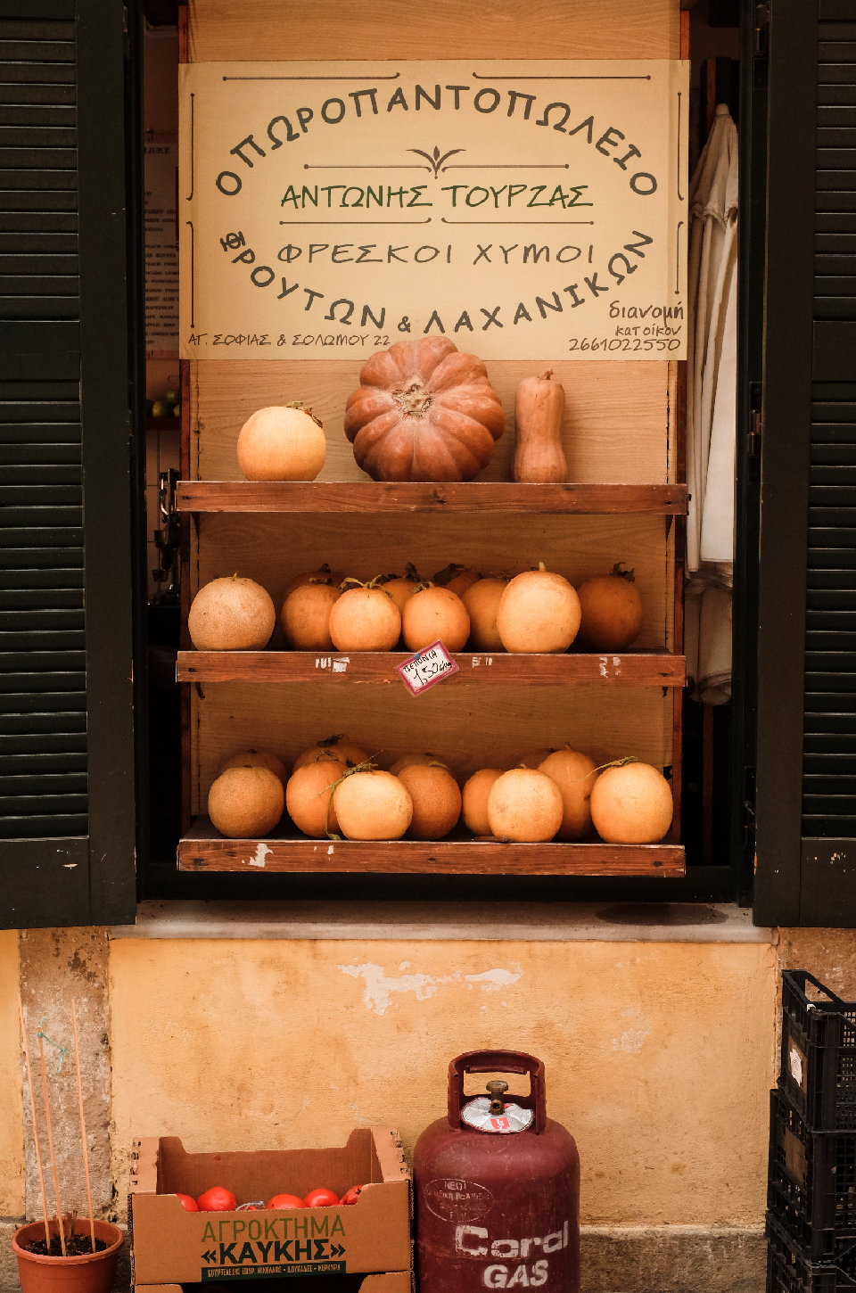 Stand of a grocery store displaying squash and pumpkins, things to do in Corfu