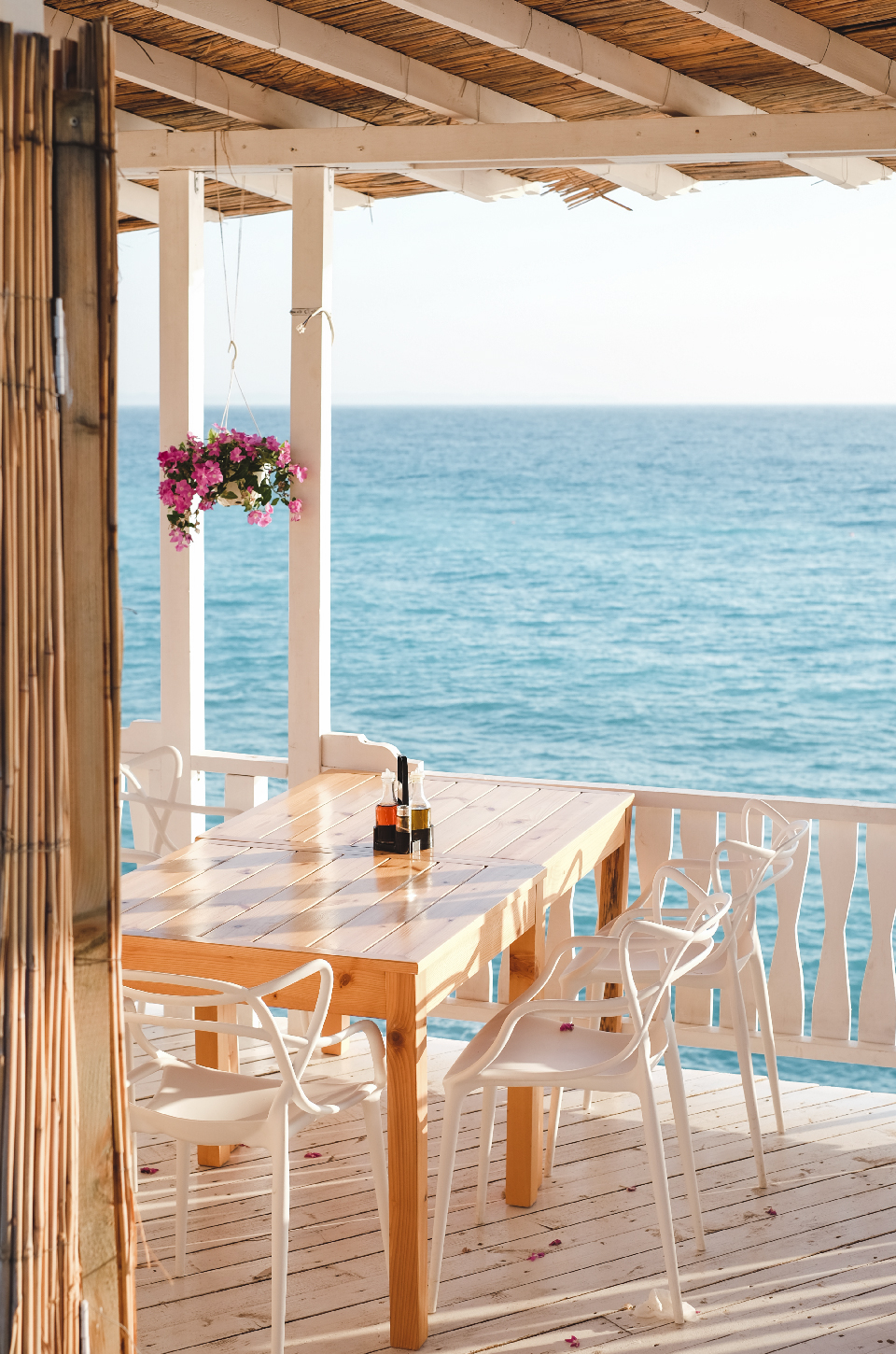 White chair and table on a terrace at Lukovë beach Albania