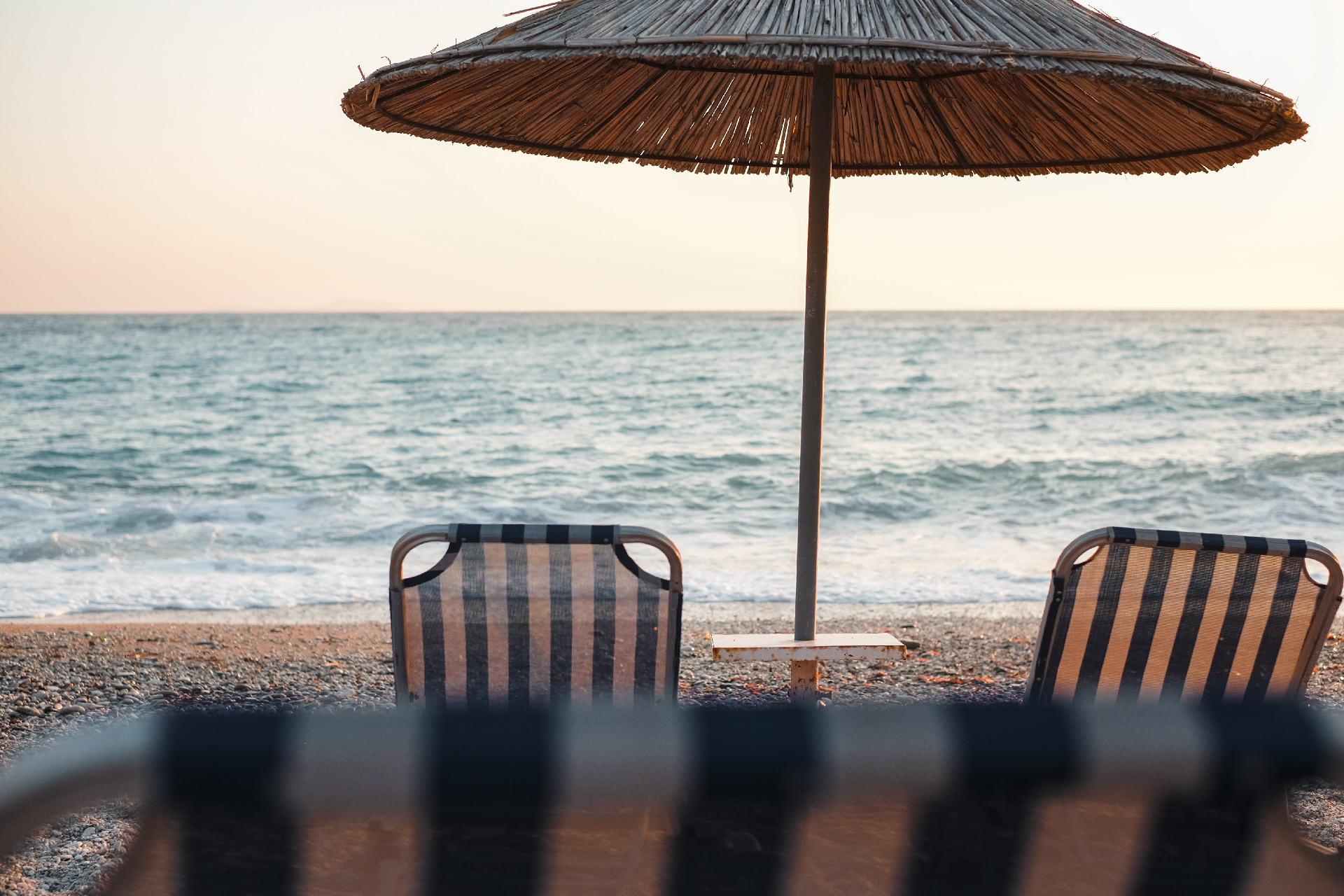 umbrella and chair in front of the water at Lukovë beach, Albania