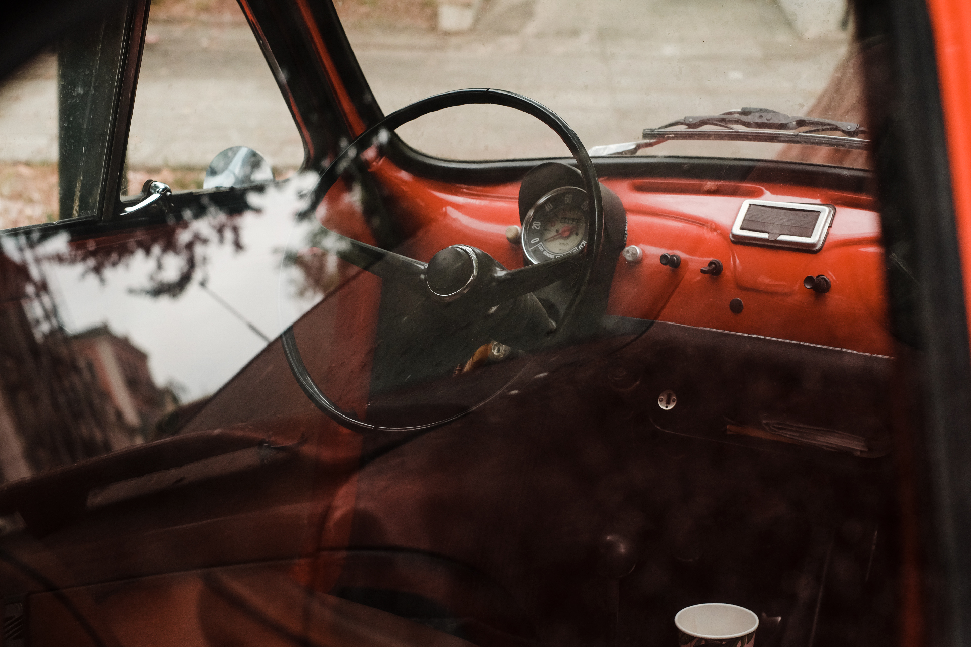 Inside of a red vintage car, weekend in Corfu