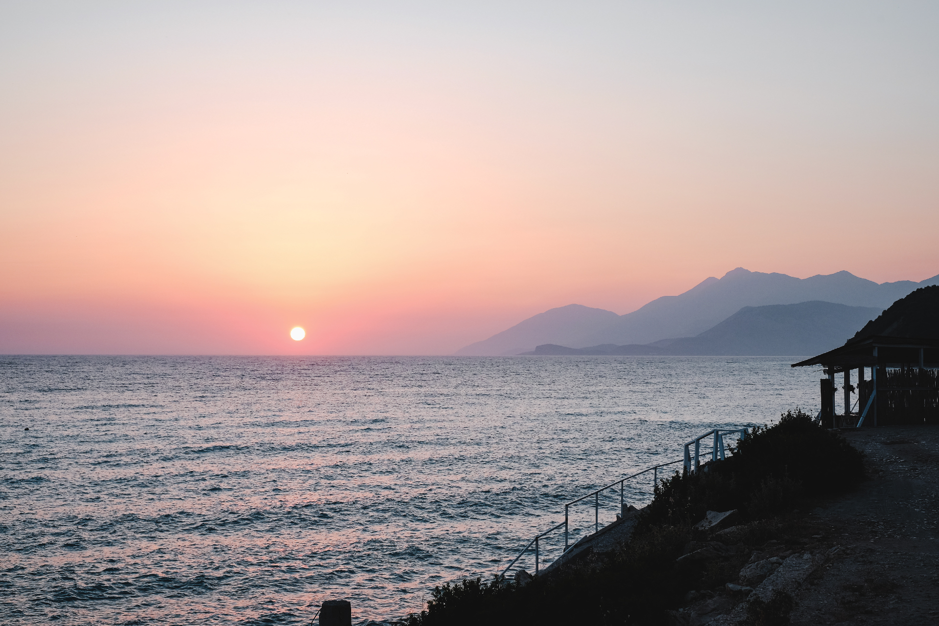 sunset at Lukovë beach with mountains in the back, Albania