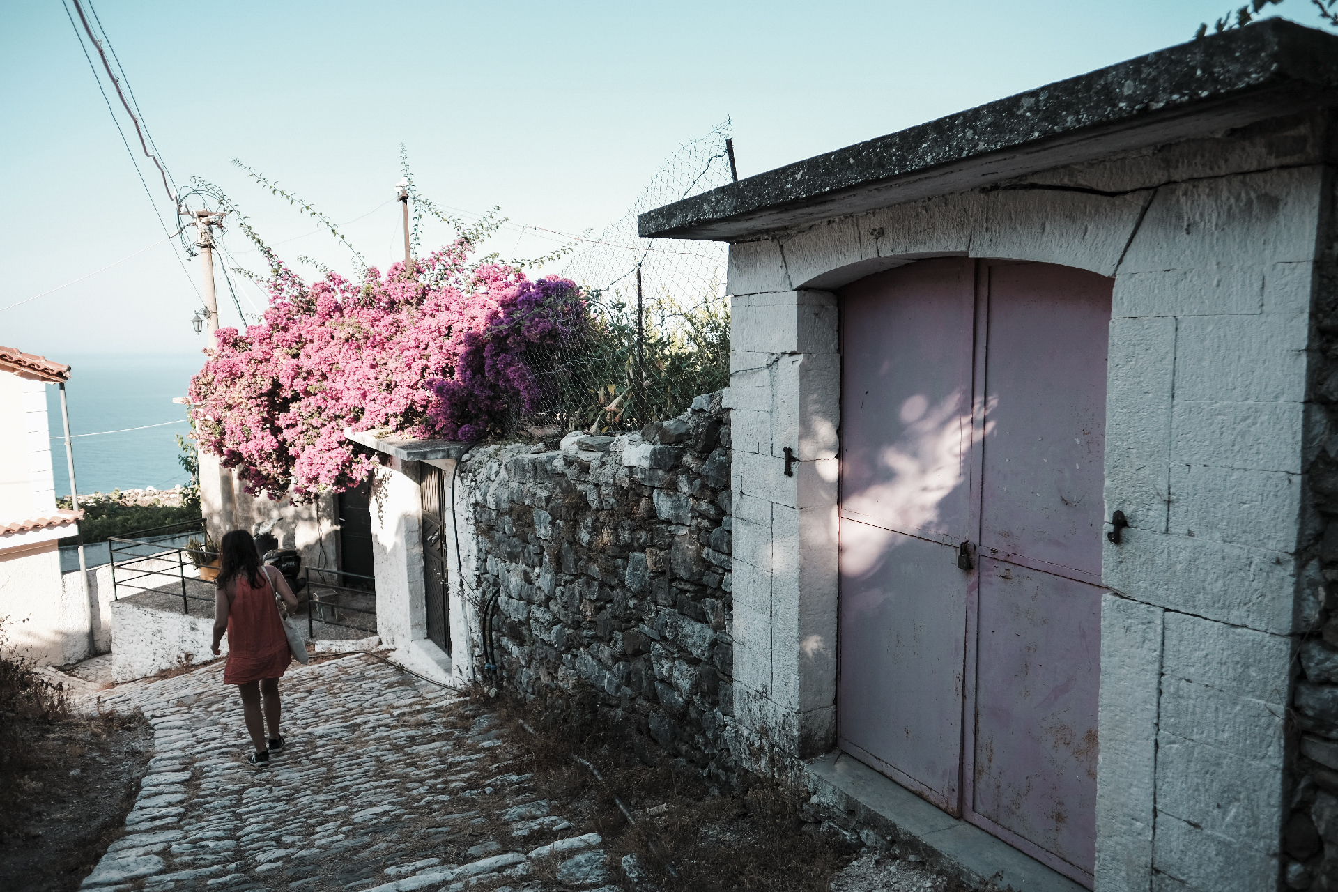 Girl walking down thwarted the streets of Lukovë Albania road trip