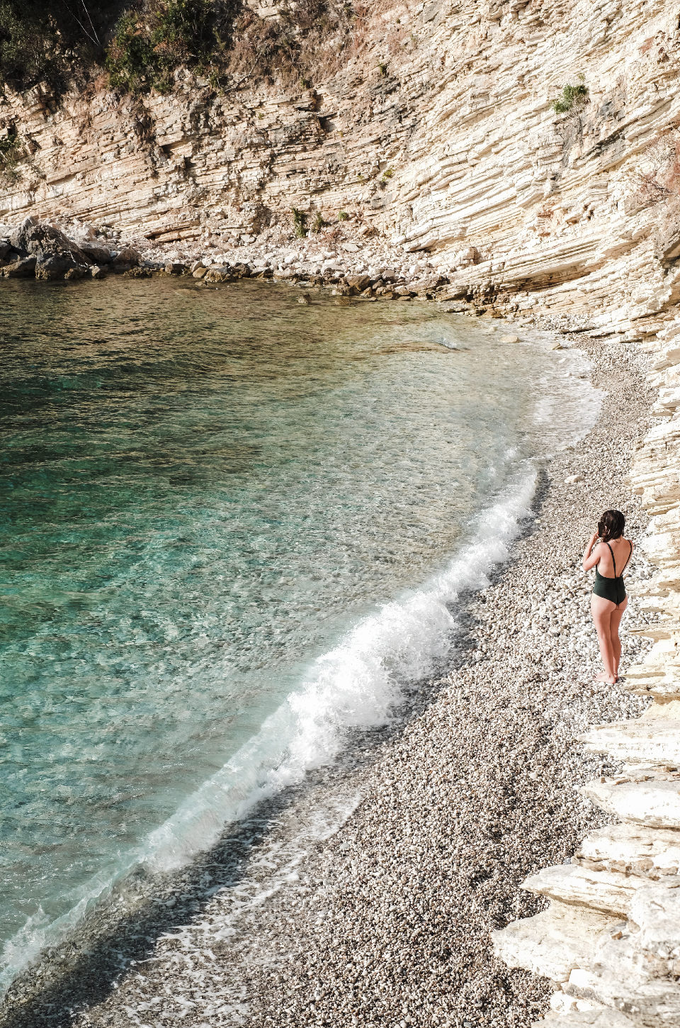 girl in swimsuit infront of the water in Albania Riviera