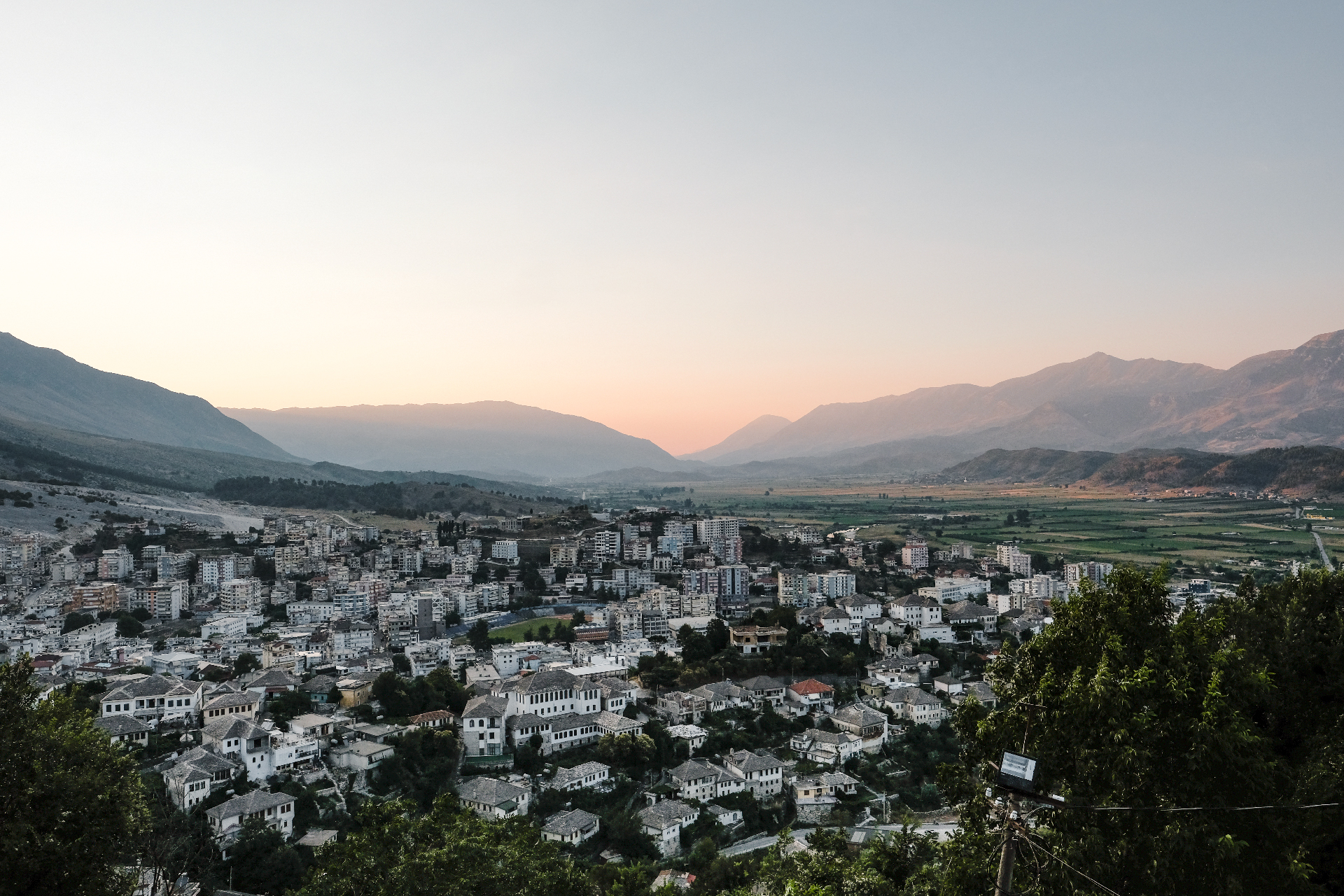 top view of Gjirokastër at sunset with mountains in the backdrop