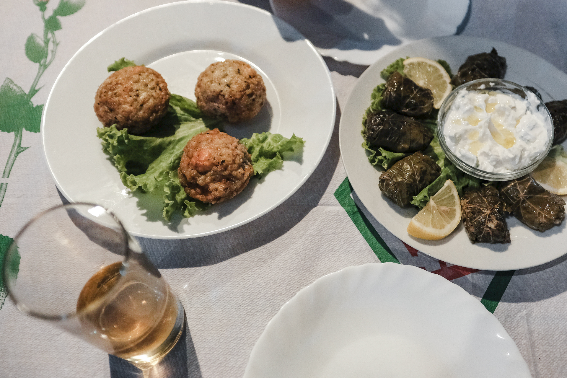 plates for dinner, dolmades and quifqi in Gjirokastër