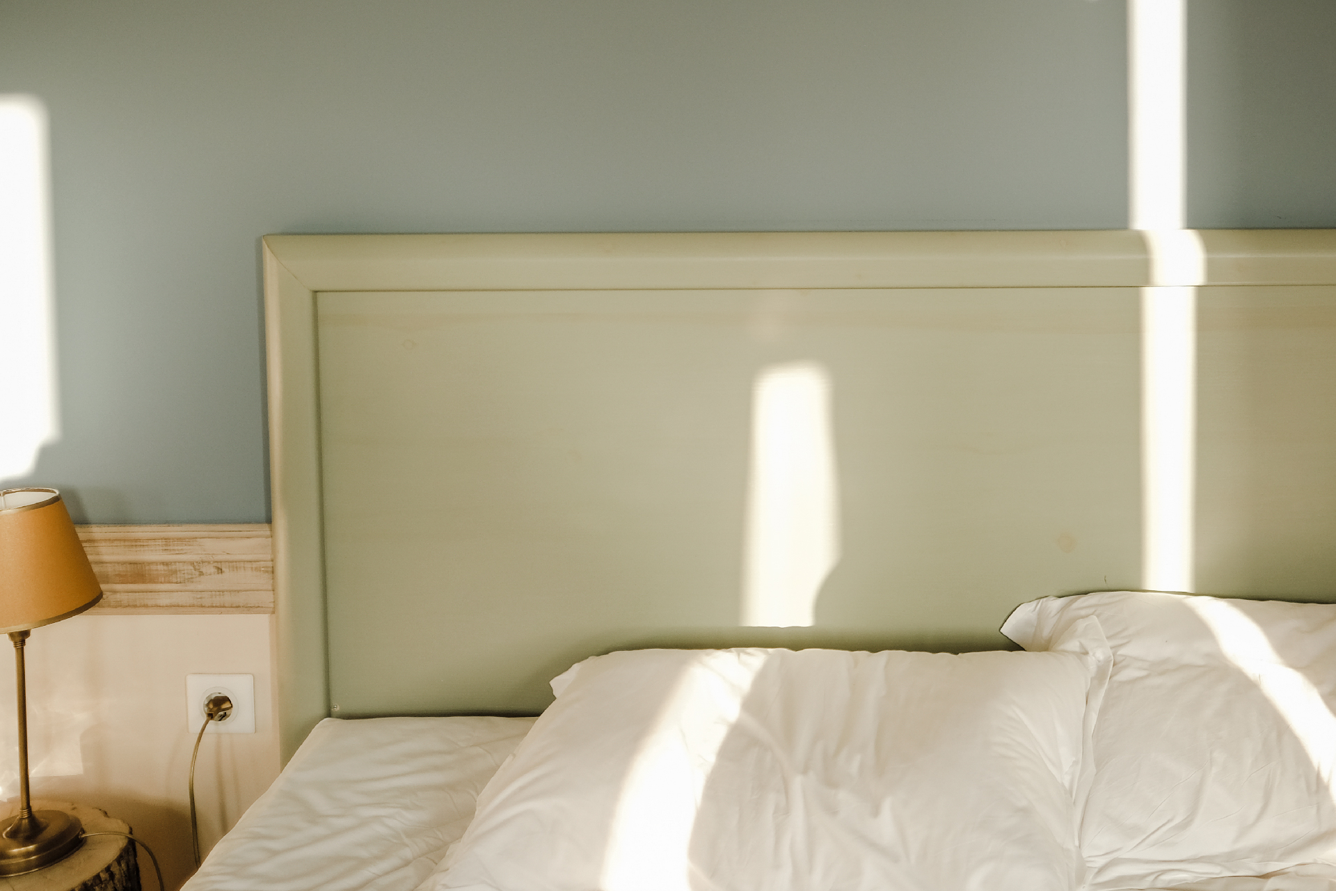 First Ray's of sunlight touching the bed in Puppet guesthouse,, things to do in Corfu